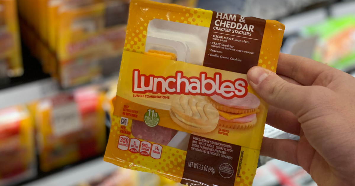 man hand holding ham and cheese lunchable in target