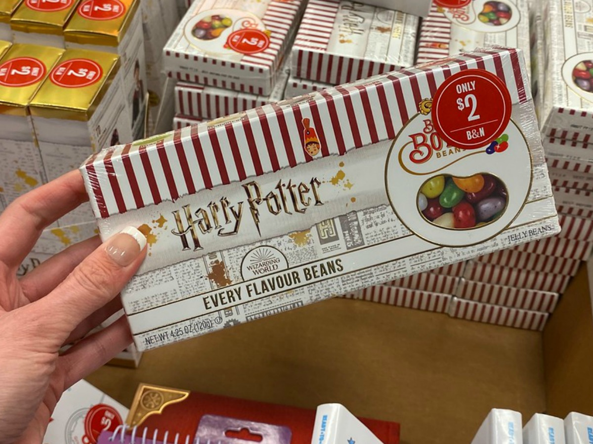 hand holding box of jelly beans in store