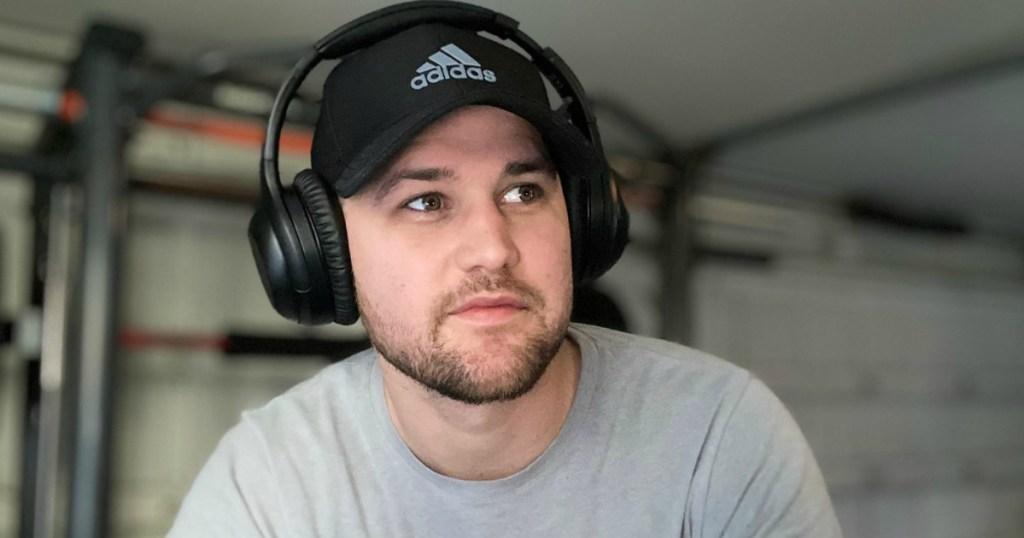 a guy wearing headphones in his garage