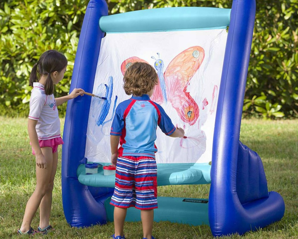 kids painting on an inflatable easel
