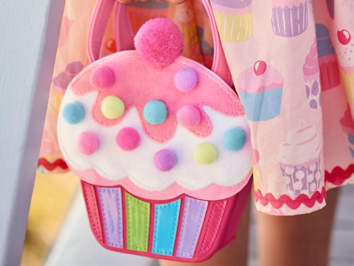 girl holding Hello Cupcake Purse wearing cupcake skirt