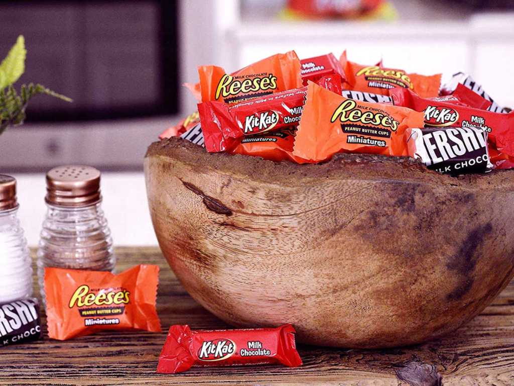 Hershey's, Kit Kat, Reese's candies in a wooden bowl
