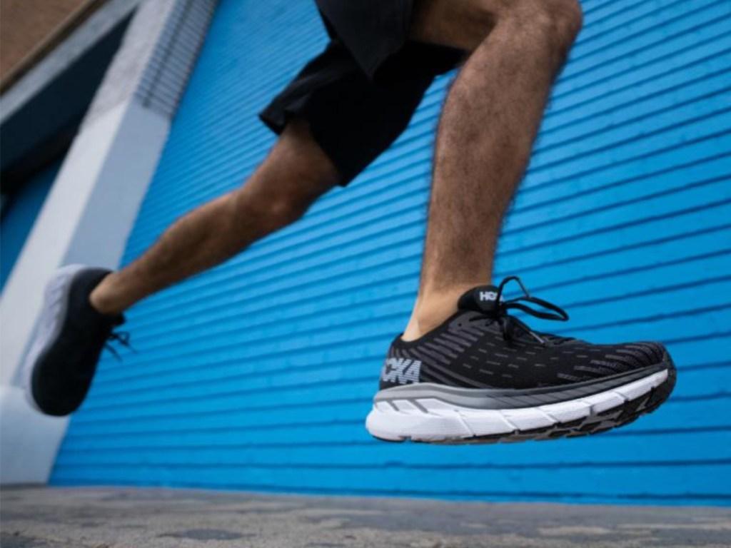 Man running in black running shoe