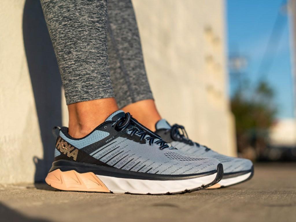 Woman wearing blue running shoe