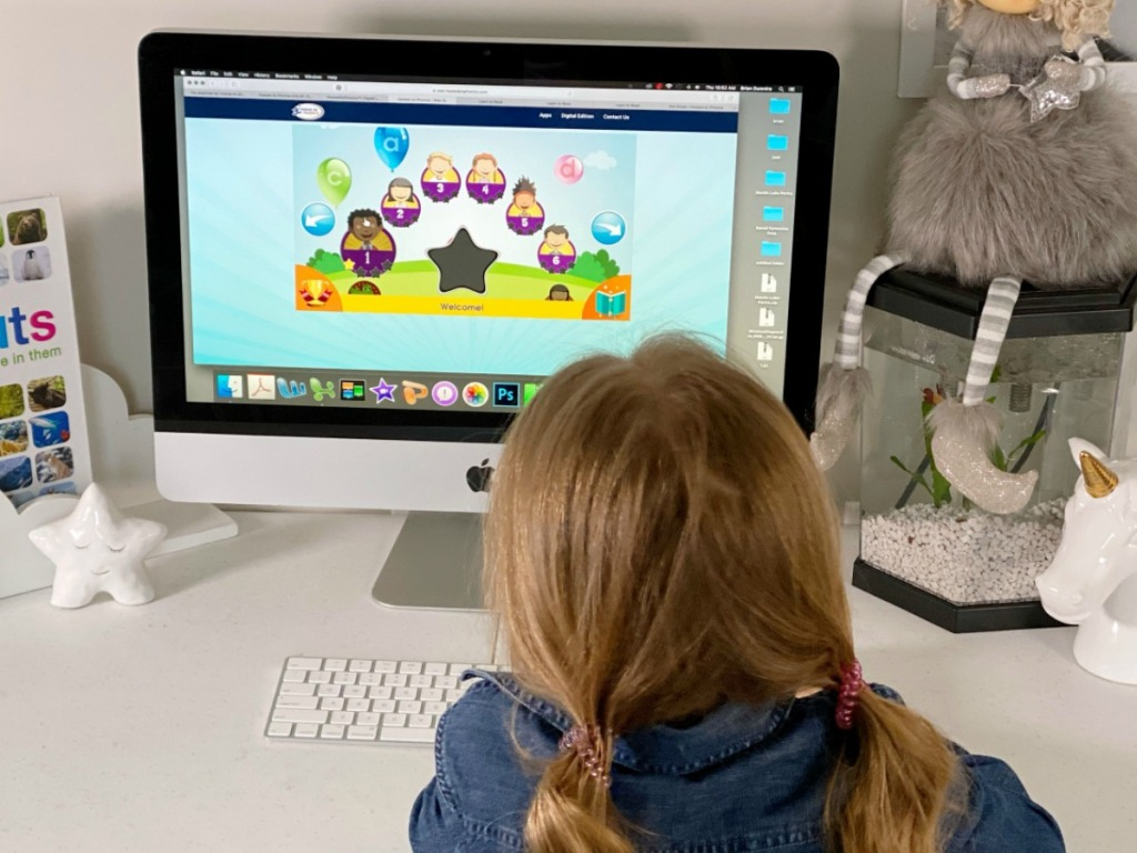 Girl playing Hooked on Phonics Digital Program