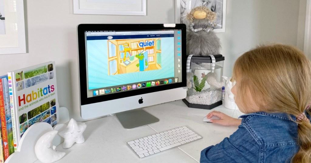Girl playing Hooked on Phonics on Mac computer