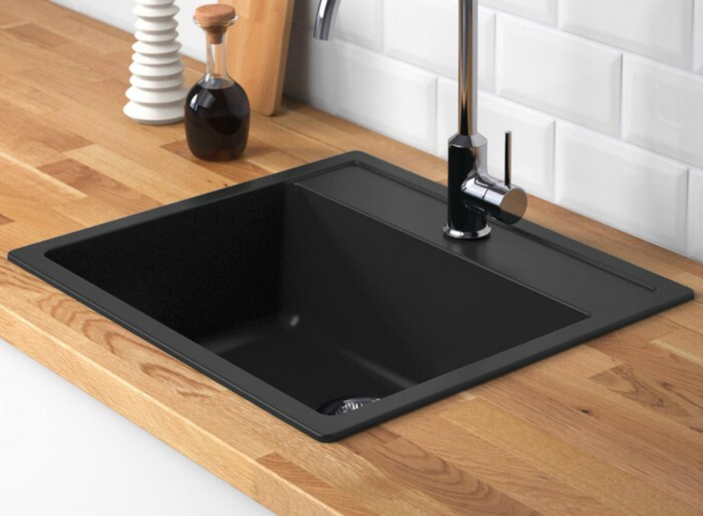 Black sink from IKEA with faucet and wooden counter top