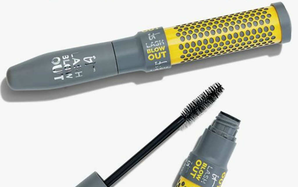 Two tubes of mascaras, one closed and one opened, on white surface