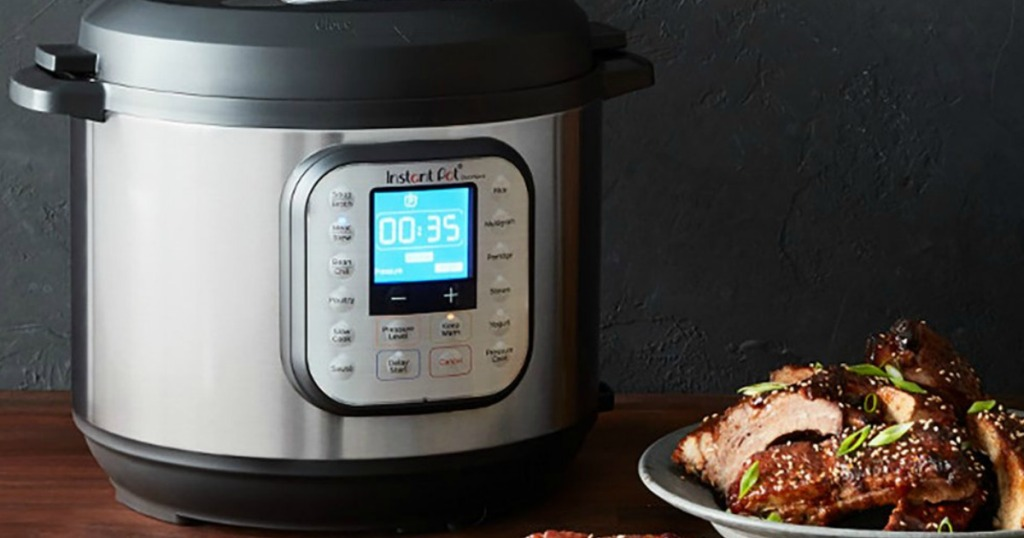 Instant Pot with plate of meat next to it