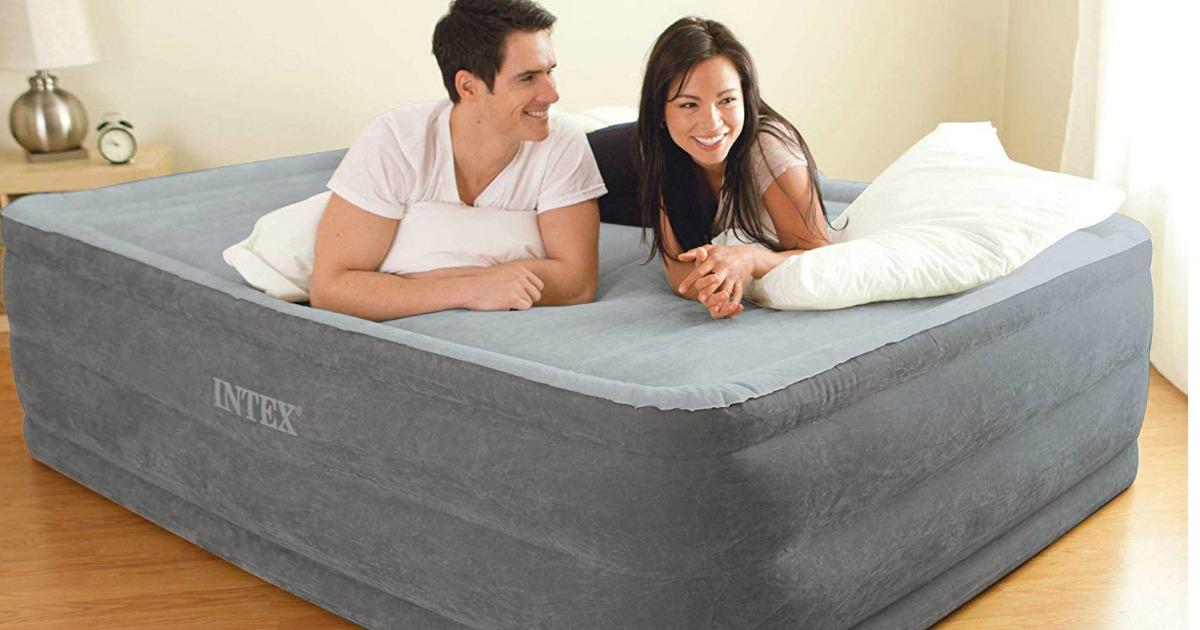 Couple laying on Intex Air Mattress