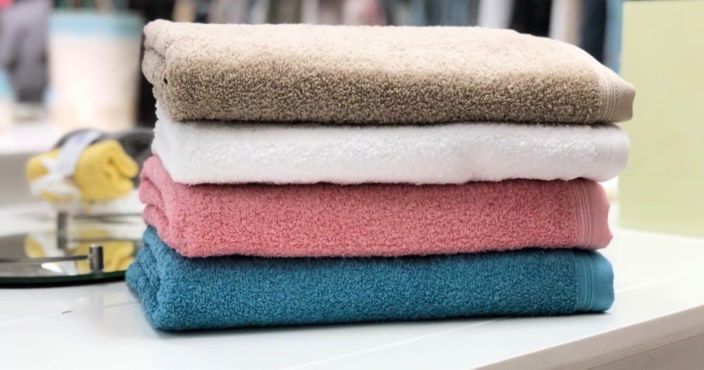 tan, white, pink, and blue towels at jcpenney