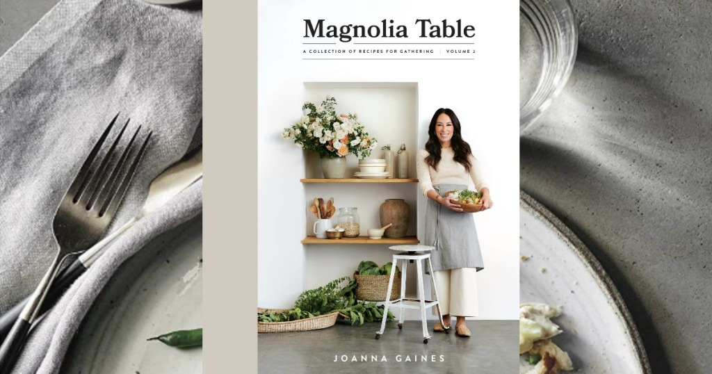 Cookbook with woman on cover in front of plated table view