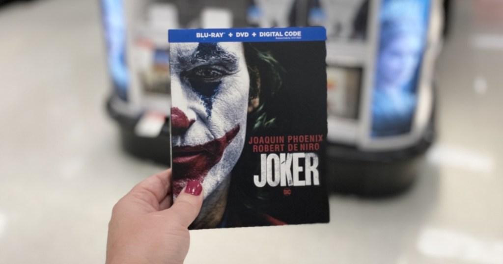 hand holding joker movie at target