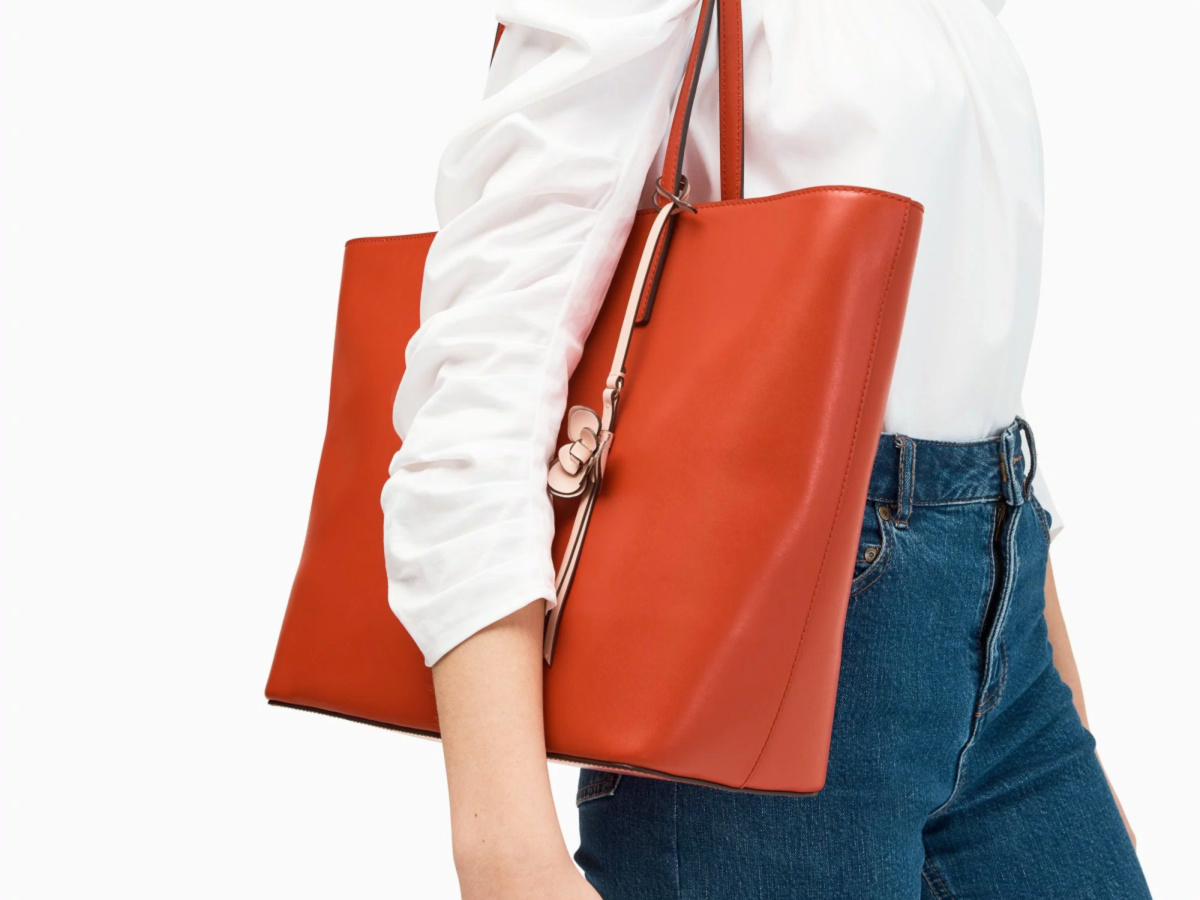 Woman holding red tote bag