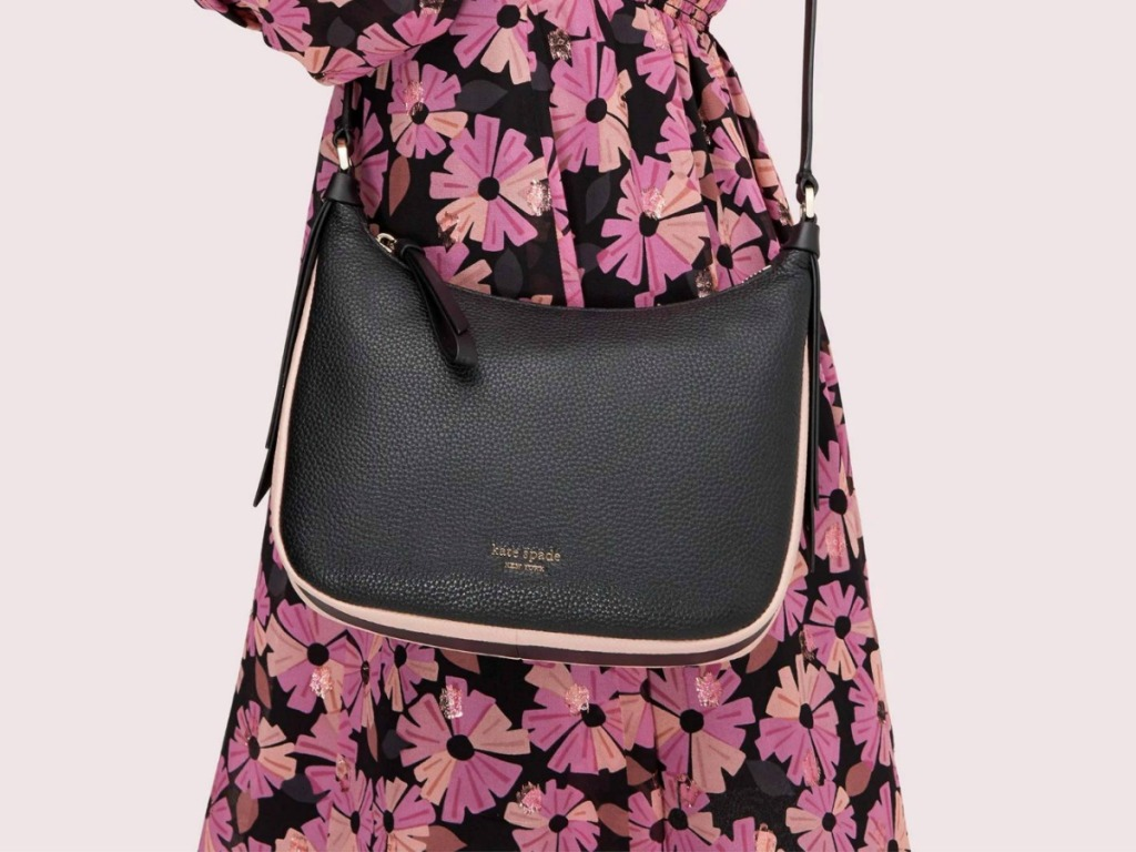 Woman wearing a floral dress and a black crossbody style bag