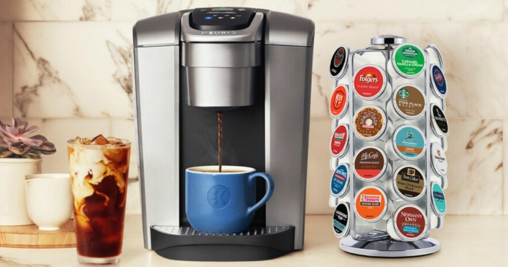 Keurig machine on counter next to coffee pod carousel and glass of iced coffee
