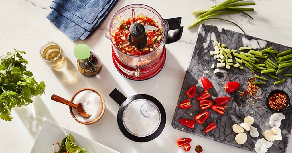 KitchenAid food chopper surrounded by salsa ingredients