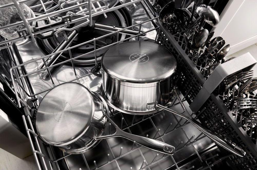 rack in a dishwasher with pans on it