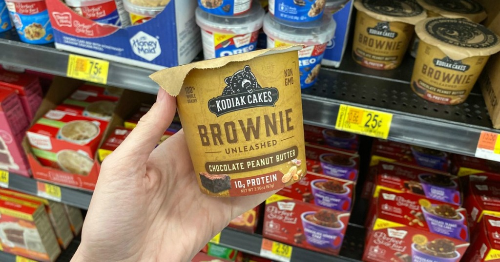 woman holding a cup of Kodiak Cakes Brownie Unleashed mix