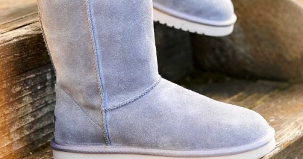 Gray UGG Boots on wooden steps