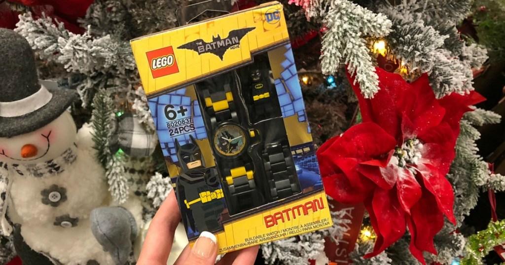 woman holding LEGO Batman watch