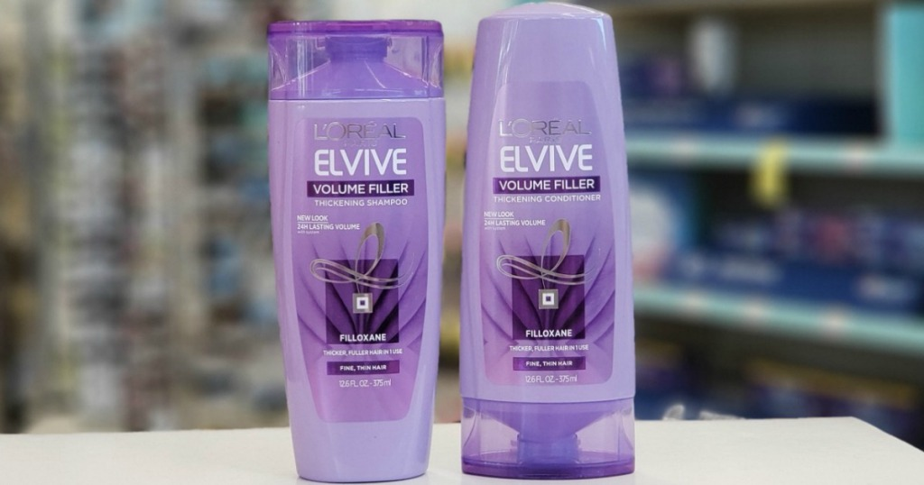 Two bottles of haircare products on counter in-store