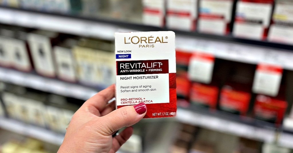L'Oreal Revitalift Anti-Wrinkle + Firming Night Moisturizer in woman's hand in store aisle