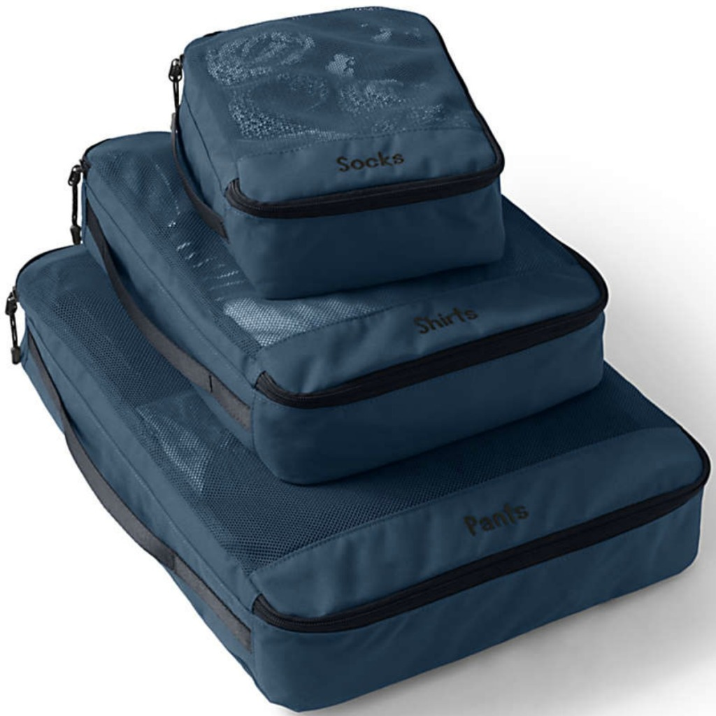 Stack of navy travel cubes in various sizes