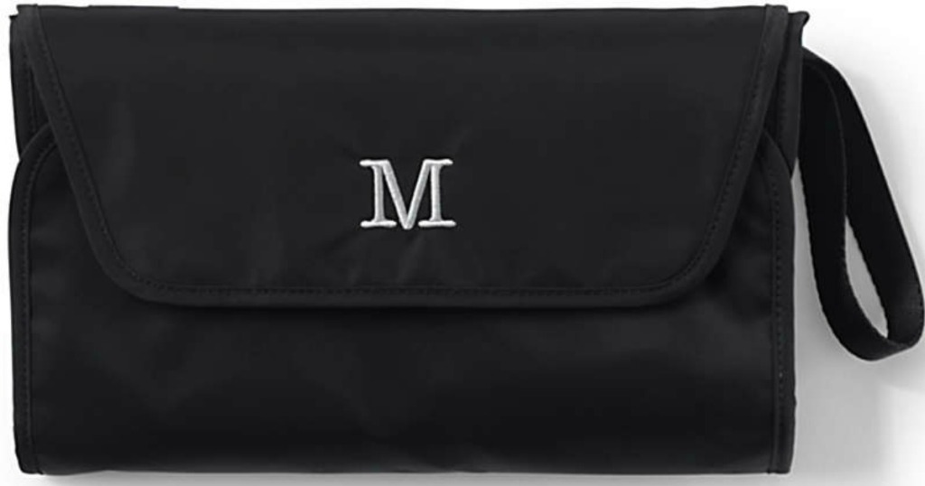 black diaper clutch with M monogrammed on it