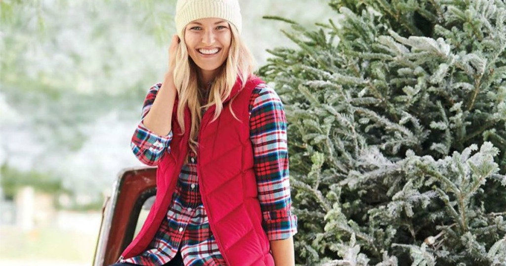 woman wearing red puffer vest and flannel