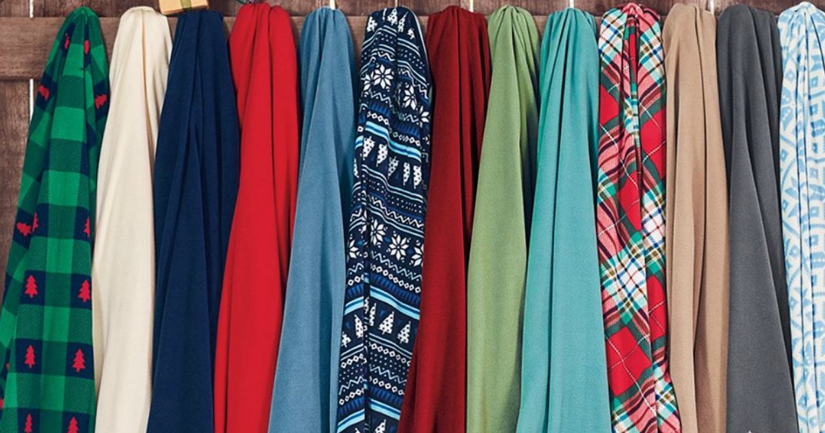 various Lands' End throw blankets hanging on a wooden fence