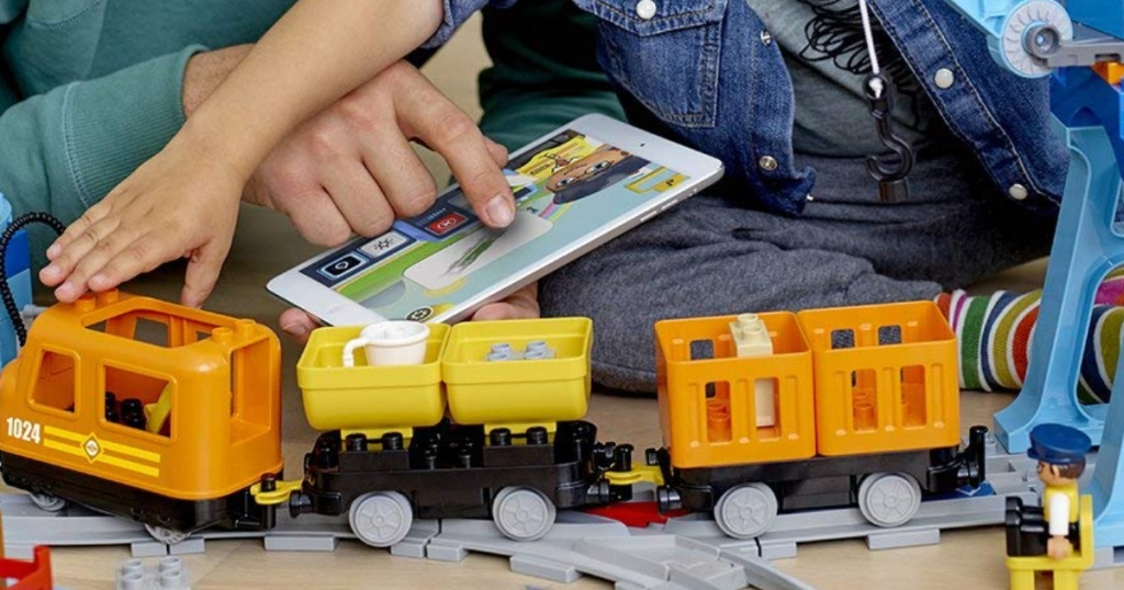 Man and little boy playing with Lego Duplo Train