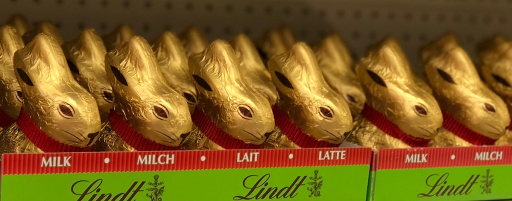 Lindt Chocolate Bunnies in rows on shelf at store
