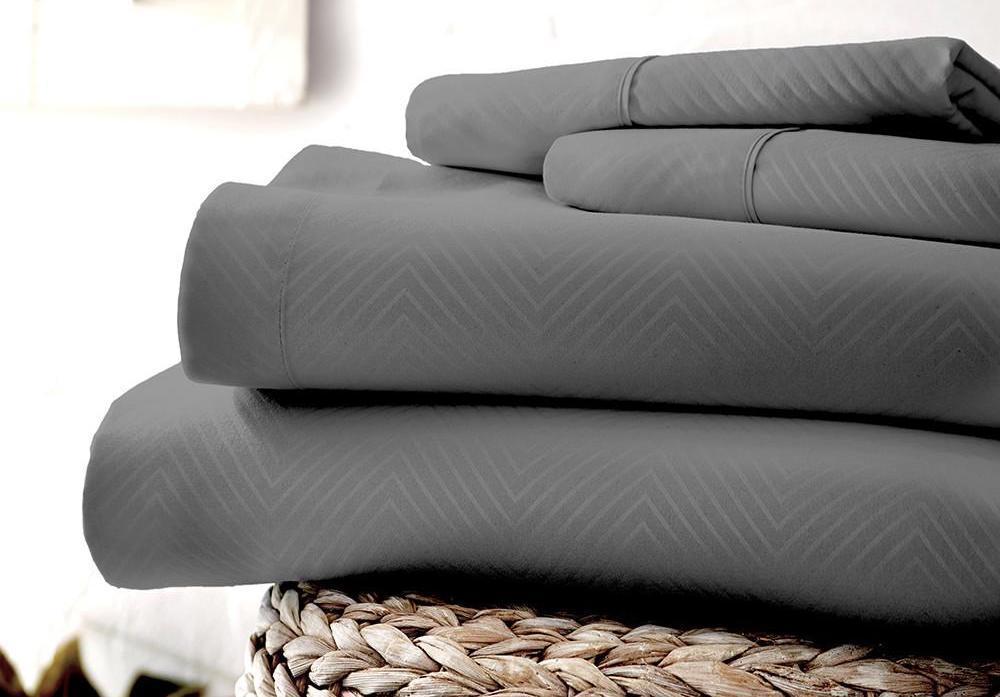 folded sheets sitting on a basket