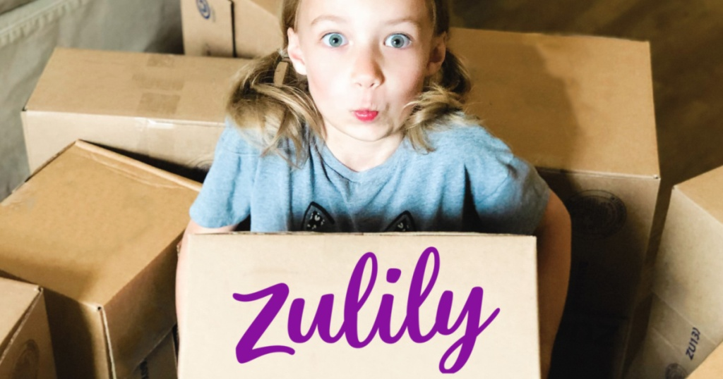 Little Girl holding Zulily Boxes