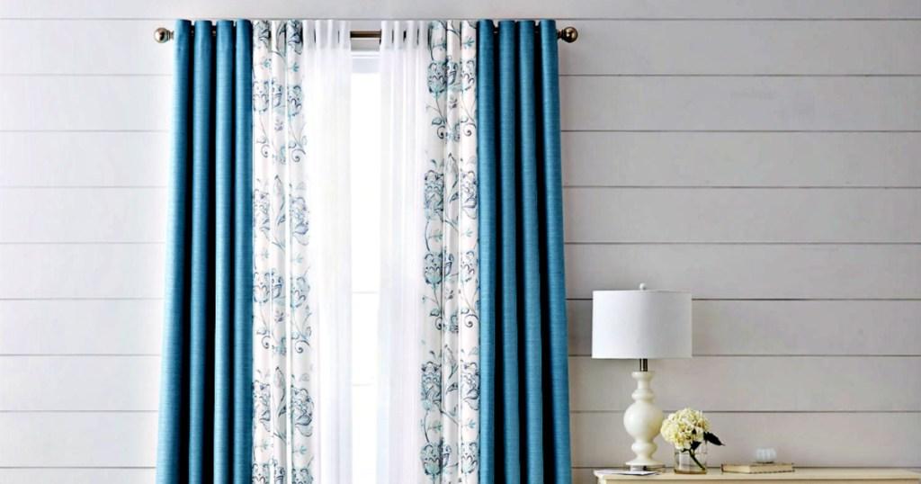 Liz Claiborne Quinn Basketweave Room-Darkening Grommet Top Single Curtain Panel on window in livingroom with lamp
