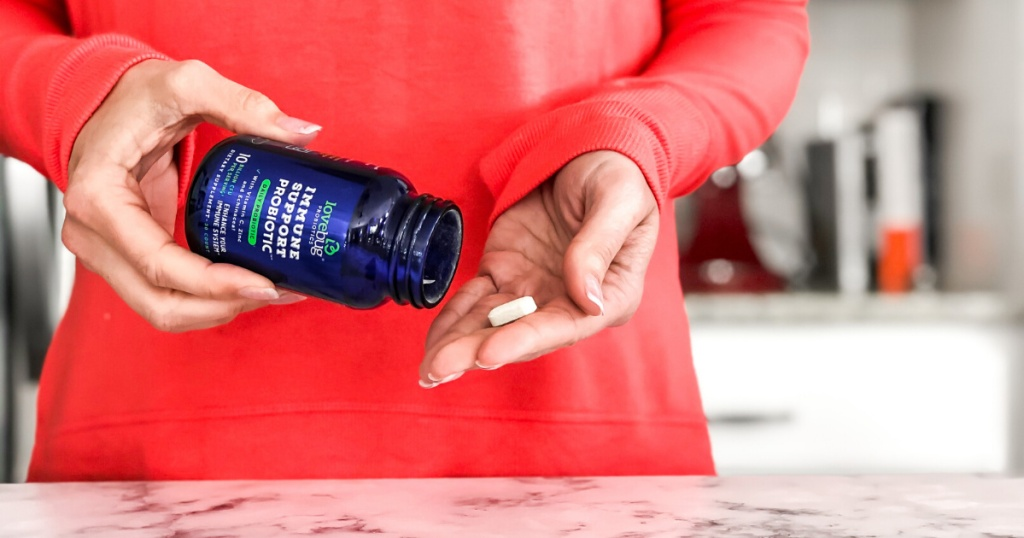 Lovebug Probiotic Immune Support Wellness pill in woman's hand