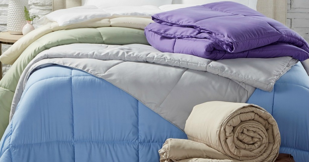 Bed made up with multiple comforters in various colors