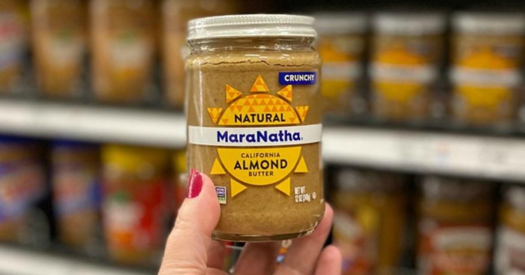 lady holding MaraNatha Almond Butter