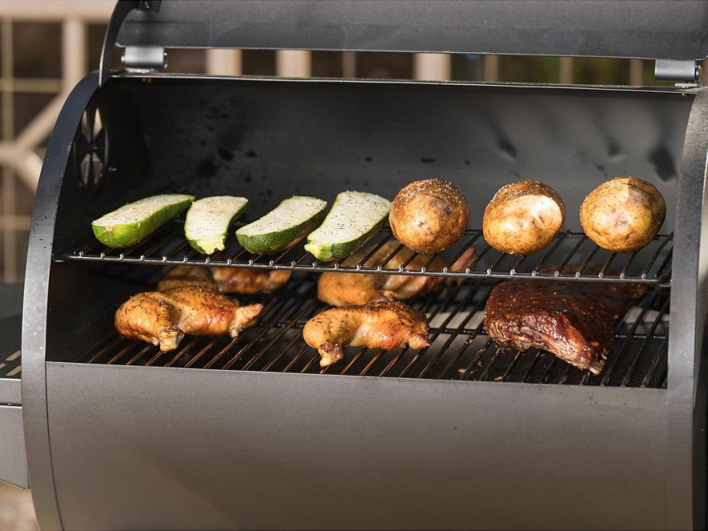 Large grill/smoker with veggies, chicken, and potatoes cooking