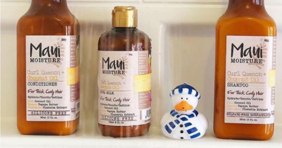 Bathtub with three haircare products and rubber ducky