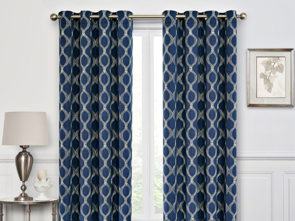 Geometric Blue and Gold Curtain Panels on window of livingroom with lamp and picture on sides