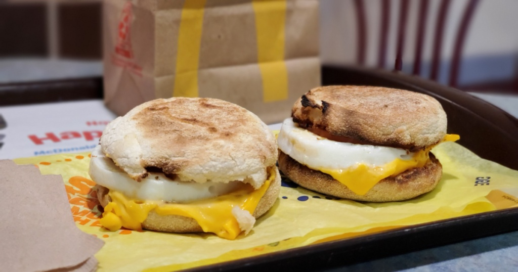 two egg mcmuffins on tray with mcdonalds bag in the background
