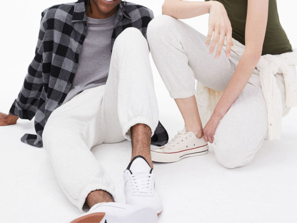 man and woman wearing white Men's Aero87 Taped Jogger Sweatpants