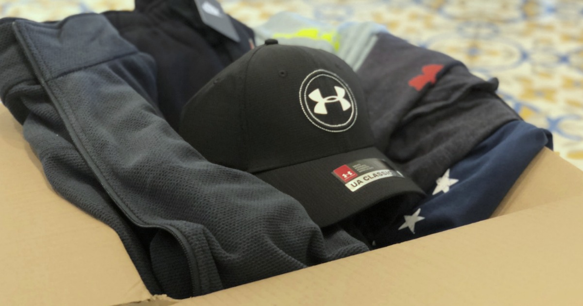Large shipping box of men's Under Armour and Nike apparel