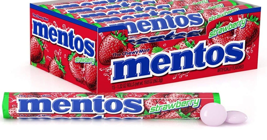 Strawberry Mentos box with a single roll of mentos laying in front, with two mentos out of the package