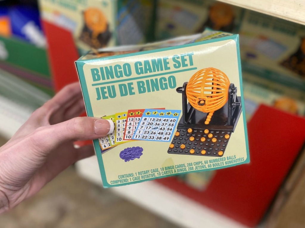 hand holding small box with BINGO game in store