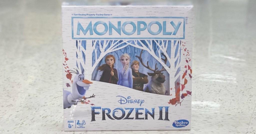 Monopoly Frozen board game on floor of store