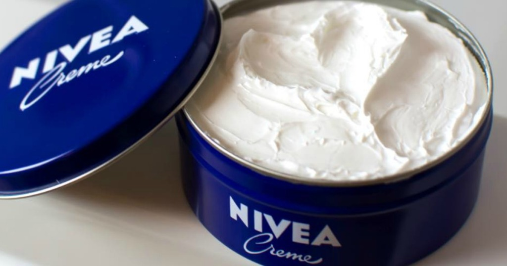Nivea Creme tin with lid off and sitting next to it