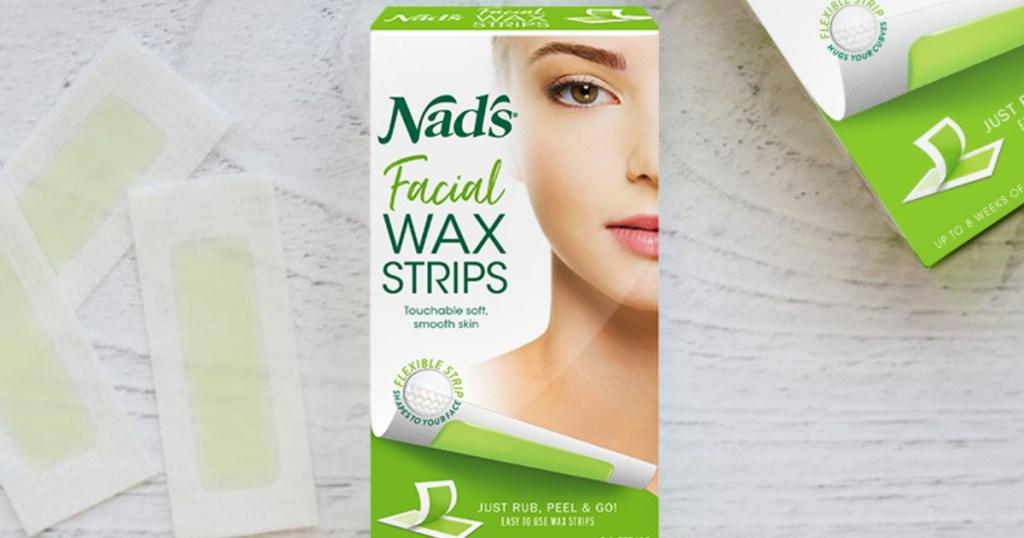 Box of facial wax strips on counter top near wax strips